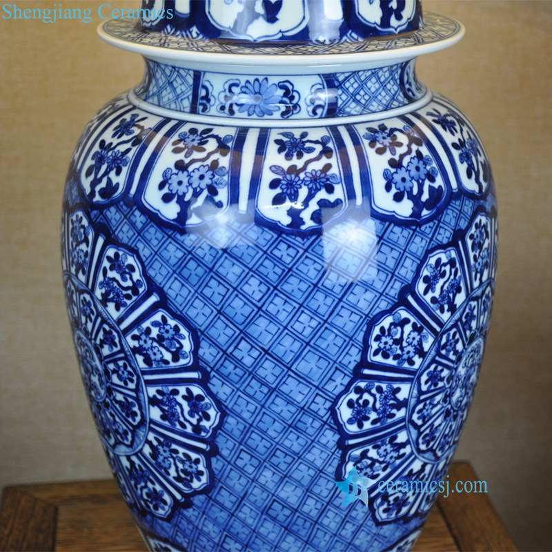 blue and white ceramic lamp with flower pattern